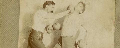 Two men in an old boxing match